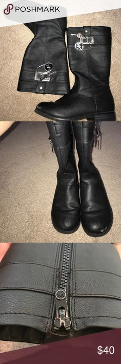 Girls Michael Kors black leather boots Used girls black leather Micheal Kors boots size 13 with huge lock and key dangling emblems on the top of each side Michael Kors Shoes Boots
