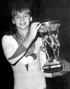 Nadia Comaneci holding a trophy