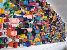 great group art project using cylinders of paperWe could use a long sheet of paper, place on ground and kids pay one ticket per cylinder to glue onto group mural. This could then dry and be hung in the MPR.