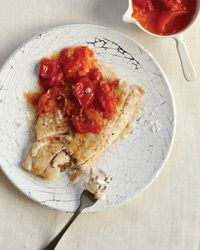Wild Striped Bass with Tomato Fondue Recipe from Food & Wine. A good Paleo recipe. Substitute regular butter for clarified butter and you're all good