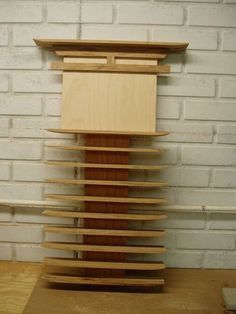 Wooden karate belt display.  Anyone want to build us two of these?