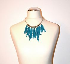 Turqouise leather necklace with tassels and silver details