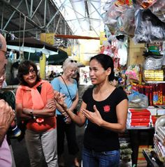 Hidden Hanoi is an awesome website with Walking Tours of Old Quarter and French Quarter and Cooking Classes.