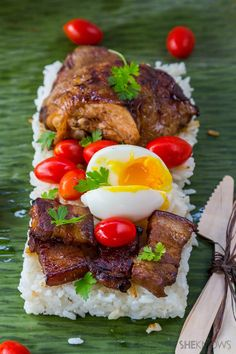 Try this Filipino chicken pork adobo and steamed rice wrapped in banana leaves