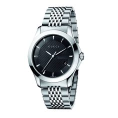 8581e9e74fc3 This classic timepiece by Gucci features a stainless steel case and  bracelet. A black dial