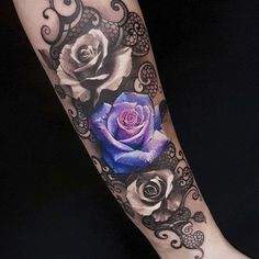 Ornamental piece with roses and a filigree lace background. Tattoo by Led Coult, an artist based in Santa Catarina, Brazil.
