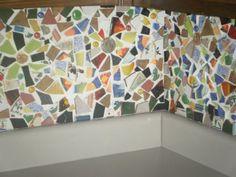 DIY mosaic kitchen backsplash from old tiles and stuff