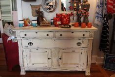 Living on the Bliss repurposes vintage finds. We brought this vintage buffet back to life with chalk paint. We distressed it and waxed it with clear wax.