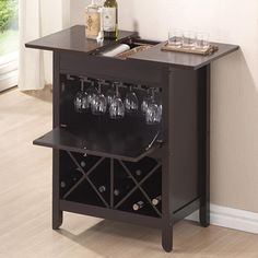 @Overstock - Materials: MDF, rubber wood veneer  Capacity: At least eight (8) bottles of wine and up to 10 wine glasses  Dark brown rubber wood veneer  http://www.overstock.com/Home-Garden/Tuscany-Brown-Modern-Dry-Bar-and-Wine-Cabinet/6198699/product.html?CID=214117 $229.99