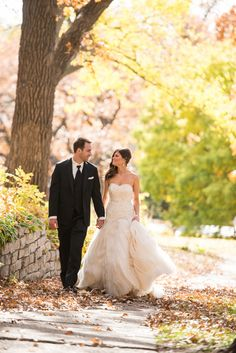 "The wedding was held on a perfect autumn day in Minnesota. ""We were set on having an October wedding, and although the weather that time of year can be a risk, it was a perfect sunny day and the autumn colors were at their peak in Minneapolis! So fortunate!"" says the bride. 