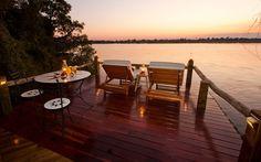 Sundowners on the deck at Sindabezi Island? Yes please! - Luxury Safari Lodge in Zambia