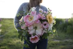 Hand tied bouquet with peonies and seasonal flowers from Floret Flower Farm.