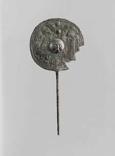 Belt clip included two characters holding palms around a face in relief. Early first millennium BC - Luristan. Louvre Museum