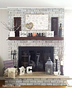 DIY fireplace renovation; a step-by-step tutorial on how to whitewash brick and update brass. Source list of fireplace decor included.