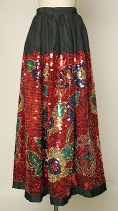 Skirt Date: ca. 1930 Culture: Mexican Medium: silk, cotton, plastic, glass Dimensions: Length: 41 1/2 in. (105.4 cm) Credit Line: Gift of Dorita Solér, for the Estate of Mimi Blaker, 1978 http://www.metmuseum.org/Collections/search-the-collections/89956?rpp=20&pg=16&rndkey=20140326&ao=on&ft=*&deptids=8&pos=304
