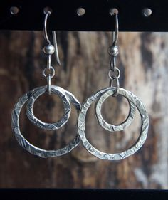 Hammered fine silver double circle dangles - .999 Fine Silver earrings - Minimalist textured Sterling Silver artisan earrings - by silverpirate on Etsy https://www.etsy.com/listing/246321588/hammered-fine-silver-double-circle