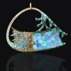 Georges Fouquet Pendant, 18K yellow gold maiden's profile against an opal mosaic background under a curved branch enhanced with diamonds and green enamel, c1905