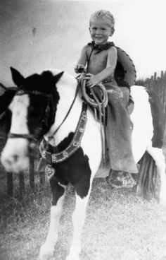Three-year-old George W. Bush rides a horse in 1949. The future President moved as a toddler with his family to West Texas and had what he has described as an idyllic upbringing in post-World War II Midland, Texas.
