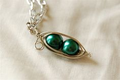 Two Peas Wire Wrapped Pea Pod Necklace with Silver Colored Chain and Dark Green Glass Pearls
