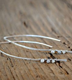 """Silver Diamond Drop Earrings (1 of 2) - handmade from tarnish-resistant argentium silver and feature curved wire backings. Three raw diamonds are attached to each earring with wire. Each earring measures 2.5"""" in length."""