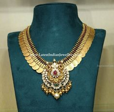 Broad Lakshmi kasu necklace lined with pota rubies with detachable pachi work peacock pendant embellished with gold balls and south sea pearl Gold Temple Jewellery, Gold Jewellery Design, Gold Jewelry, Handmade Jewellery, Gold Necklaces, Trendy Jewelry, Gold Bangles, Pearl Jewelry, Earrings Handmade