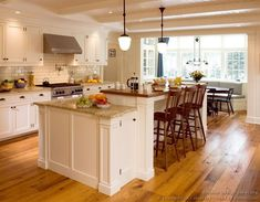 Beautiful-Cream-Kitchen-Cabinets-with-White-Kitchen-Applieances-in-Modern-Kitchen-Featuring-Hanging-Lamps-and-Brown-Vinyl-Flooring.jpg (800×622)