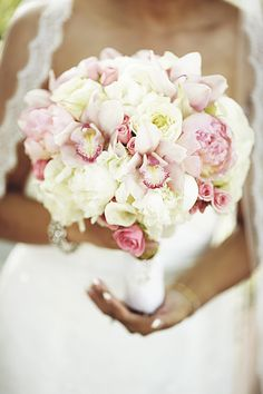 ivory and blush peony, ranunculus, cymbidium orchd, calla lily and spray rose bouquet