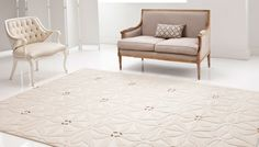 Rhode Island Hand-knotted Wool and Silk Rug by Modern Archive. Shown in Ivory, 9ft by 6ft.