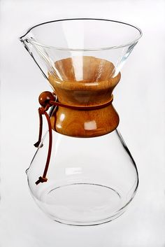 ?Chemex coffee maker Thompson did not believe all good design had to be pedigreed. One of the store's most popular items were $1 drinking glasses from Mexico. He also liked Peter Schlumbohm's 1941 Chemex coffee maker, a still-in-production and utterly simple appliance that makes excellent coffee with a minimum of moving parts (Pyrex carafe, bentwood grip, leather tie).
