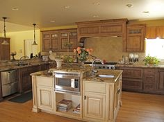 Custom Kitchen Cabinets with Knotty Alder Wood, Flushed Inset and Painted Island Cream Kitchens, Painted Island, Cream Cabinets, Knotty Alder, Custom Kitchen Cabinets, Kitchen Ideas, Web Design, House Ideas, New Homes