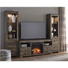 Signature Design by Ashley Trinell Rustic Large TV Stand w/ Fireplace Insert & 2 Tall Piers