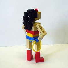 This custom made Miniland figure is perfect for any LEGO®, comic, or Wonder Woman fan. Ready to take on the world, Wonder Woman is poised to fly into action.    Stands at 4 tall. LEGO is a trademark of the LEGO Group. This site is neither owned nor operated by LEGO Systems, Inc. and is in