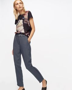 Our Relaxed Crepe Trousers have been updated for the new season with satin detail on the side seams. Made from an acetate and viscose mix, features include an elasticated waistband, press crease detailing to refine the design and a side slit hem for a contemporary finish. Wear with silk shirts or pare-back with knitwear and T-shirts from our Foundation range.