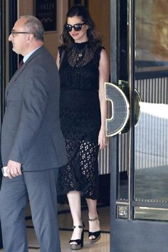 Anne Hathaway wearing Longchamp Le Pliage Heritage Crossbody Bag and Zimmermann Frilled Sheer Top