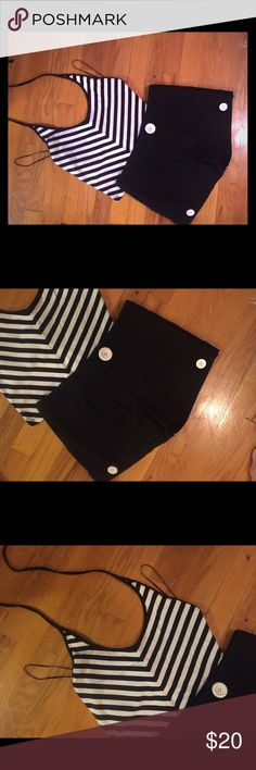 Black dress shorts and halter top Cute black dress shorts with oversized white buttons (Juniors Medium) and never worn black/white stripe halter top (Juniors M but would fit Small); ties behind neck in back Shorts