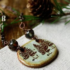 Items similar to Evergreen necklace- handmade ceramic focal on Etsy
