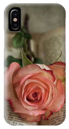 https://fineartamerica.com/products/still-life-with-pink-rose-and-old-open-book-jaroslaw-blaminsky-iphone-case-cover.html?phoneCaseType=iphone10