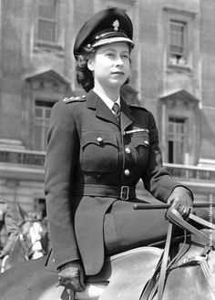 Elizabeth II 1952, riding sidesaddle, as she always did in public.