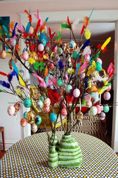 Inspired by the Swedish Easter tradition of paskris (or twigs), this tree showcases brightly colored feathers and bold eggs. And, shh, the base is made from an old detergent bottle.  Get the tutorial from Aunt Peaches»