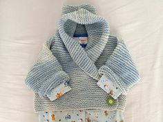Ravelry: Baby Hooded Wrap Cardigan pattern by Audrey Wilson