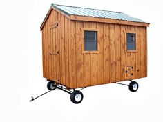 8'x10' Chicken Coop from Backyard Unlimited with heavy duty wheel system and metal roof. Includes feedroom and 8 nesting boxes: holds 24-28 chickens
