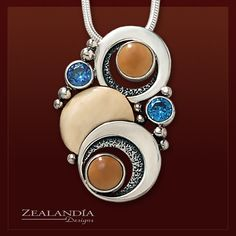 fe53792c5 Fossilized Walrus Ivory and Blue Topaz Silver Moon Necklace – Double Eclipse