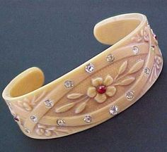 Art Deco French Ivory Celluloid Flowers Rhinestone Cuff Bracelet from vintagegrandillusions on Ruby Lane Plastic Jewelry, Old Jewelry, I Love Jewelry, Antique Jewelry, Jewlery, Vintage Jewelry, Vintage Clothing, Bijoux Art Deco, Art Deco Jewelry