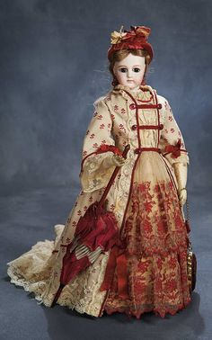 """Theriault's Antique Doll Auctions -  Poupee by Jumeau with Dramatic Large Eyes and Beautiful Costume and Accessories 18"""" - Emile Jumeau, circa 1880."""