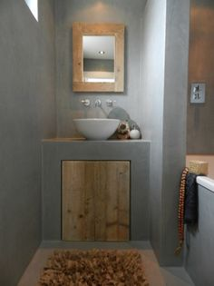 Modern meets rustic in this wood and concrete bathroom