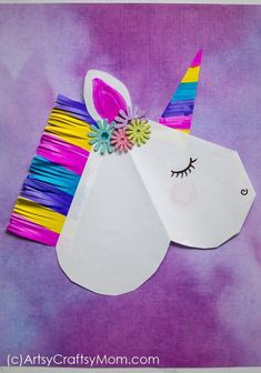Everyone loves unicorns; especially when they're as colorful as this DIY Unicorn Valentine Paper Puppet! Delight your friends with this magical creature! #unicorn #paperunicorn #puppet #rainbow