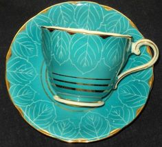 Aynsley china tea cup and saucer. England. Turquoise/Aqua with white leaves