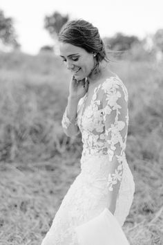 Bride with lace see-through skin detail wedding dress. Long sleeve and long train with veil. Bride with lace detail long sleeve wedding dress. #southafricanwedding #elopinginsouthafrica #capetownweddingphotographer #yolandemarx #winefarmweddingcapetownsouthafrica