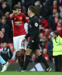 Matteo Darmian of Manchester United asks referee Mark Clattenburg why he wasn't given a penalty during the Premier League match between Manchester...