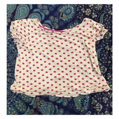 Pink Polka Dotted Crop Top Super cute, has a small hole (pictured above) near the bottom hem of the shirt. Other than that no flaws. Tops Crop Tops